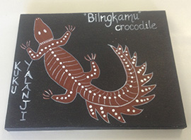 Painting of a crocodile with the words 'KUKU YALANGI' and 'Bilngkamu crocodile