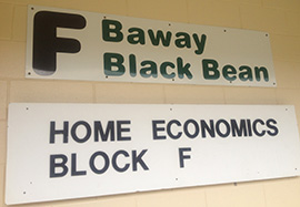 Wall sign saying 'F Baway BlackBean' and 'Home Economics Block F